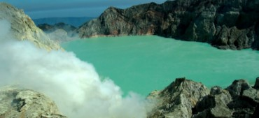 Ijen crater lake with smoke