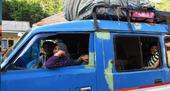 Sitting in local transport on yout way to the Ijen Plateau - East Java, Indonesia